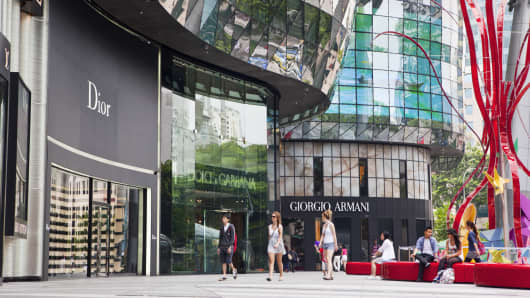 Shoppers at the ION Orchard Mall, in the shopping district of Orchard Road, Singapore.